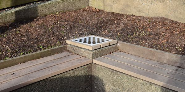 Chess-Board-Inset-Into-Small-Table-on-Wall-Seat