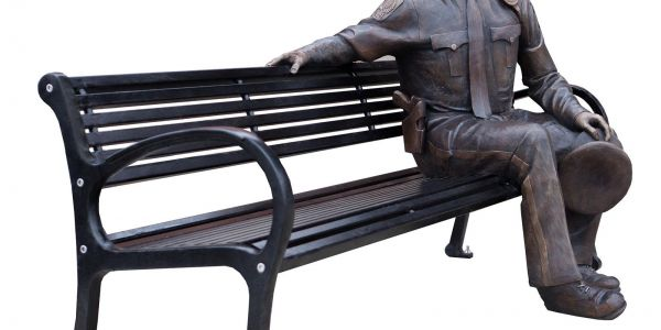 Nathan-Scott-Police-Officer-Scuplture-on-Wishbone-All-Metal-Mountain-Classic-Bench-in-Lacomb-Alberta